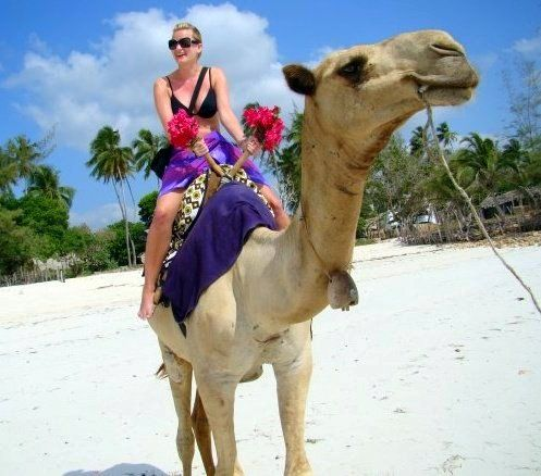 """Lisa, seeing what all the camel-riding fuss is about in Mombasa.  She reports: """"It was uncomfortable, scary, and awesome all at the same time."""" Click for advice from Lisa on traveling and teaching in Asia and Africa!: Lisa Vinish, Travel Pictures, Teaching Travel, Camels Rid Fuss, Exploring Kenya, Southeast Asia, South Korea"""