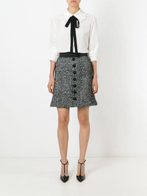 falda de tweed con botones