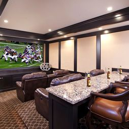 Adding a bar/eating area into the home cinema room is a great attribute and makes multi-function entertaining (e.g. a Super Bowl party versus simple movie watching) more condusive for guests.