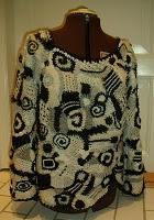 Black and white sweater in freeform knitting/crocheting
