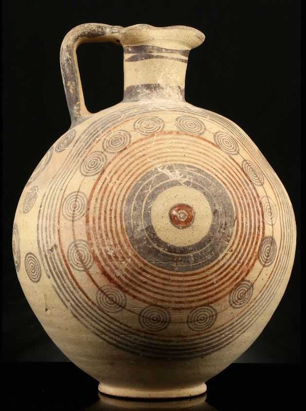 Cypriot bichrome ware jug, Cypro-Archaic period, 750-600 B.C. With trefoil lip and double strap handle, the globular body decorated with circular lines and multiple concentric circles, on ring foot, 36.5 cm high. Private collection