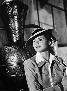Casablanca (1942) starring Ingrid Bergman and Humphrey Bogart. Two-piece suits for women, trench coats for men, and fedoras complete this 1940's look.---- I love the clothes from this period.