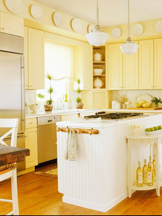 Sunny Yellow. Love this!  My kitchen layout is similar.  I should consider painting the cabinets yellow with beadboard on my island!  Love it.  I repinned this from http://www.bhg.com/kitchen/cabinets/makeovers/low-cost-kitchen-cabinet-makeovers/#page=16