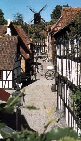 "Old Town, Aarhus - The town itself is the main attraction with most buildings open for visitors; rooms are either decorated in the original historical style or organized into larger exhibits of which there are 5 regular with varying themes. There are several groceries, diners and workshops spread throughout the town with museum staff working in the roles of town figures i.e. merchant, blacksmith etc. adding to the illusion of a ""living"" town. DENMARK"