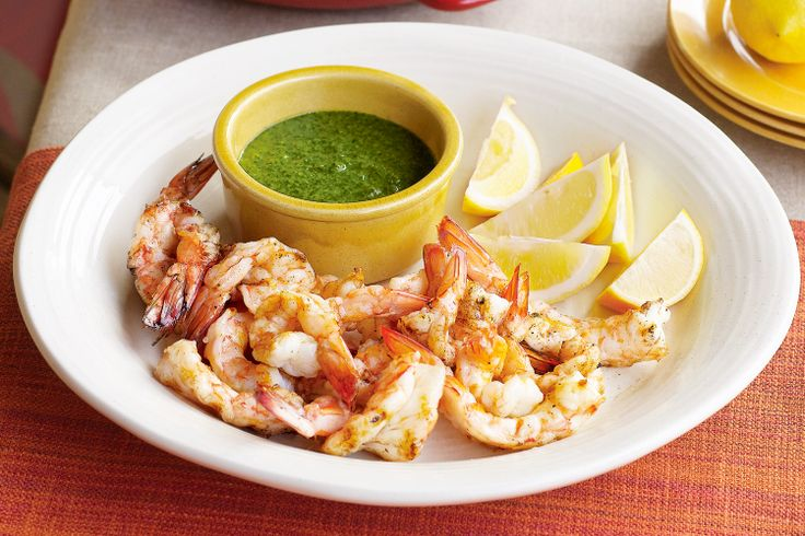 Drizzle the green chilli and parsley sauce over the barbecued prawns for a festive touch.