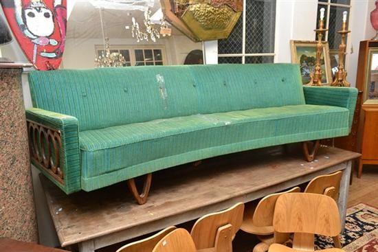 A 1960s JAKOB RUDOWSKI CURVED SOFA (some major rips to upholstery) $800-$1200