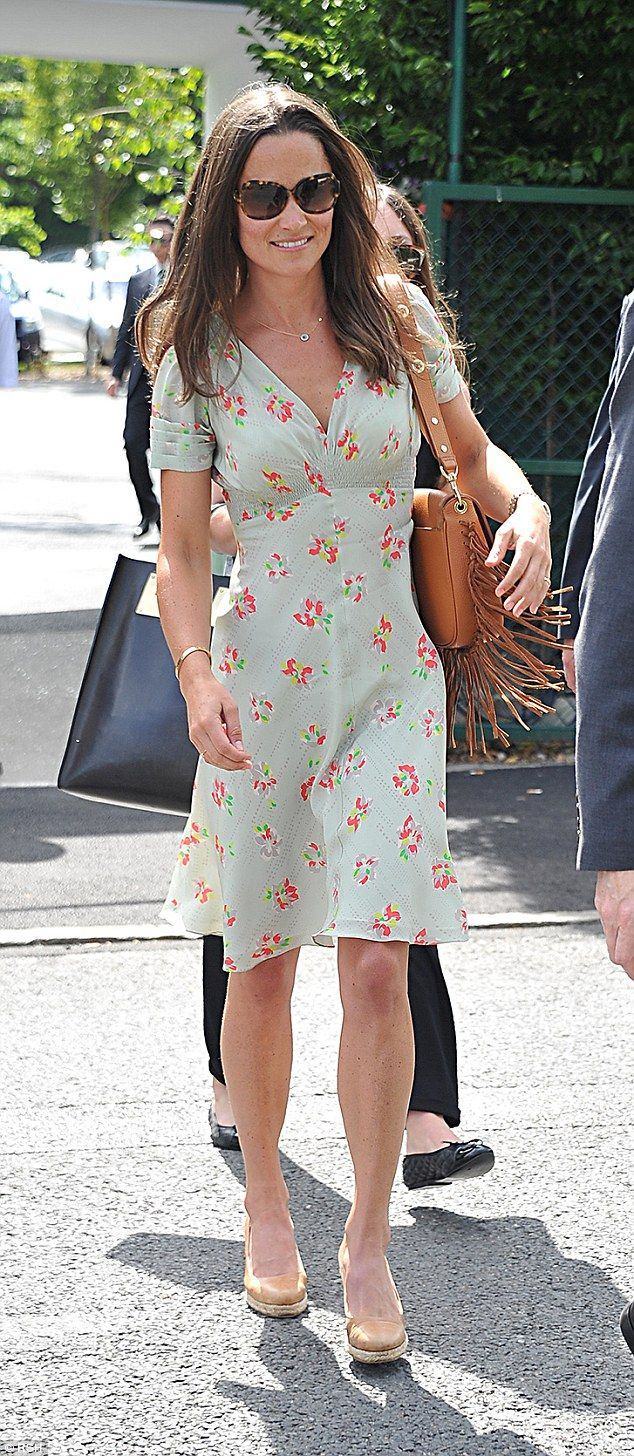 Pippa Middleton arrived at the Wimbledon Championships in a floaty silk tea dress and nude...