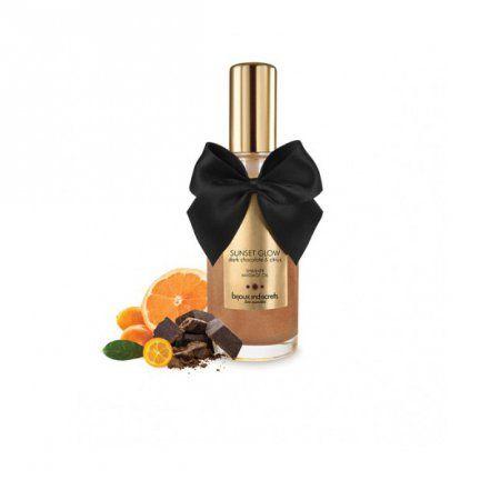 """SUNSET GLOW - Dark Chocolate Shimmer Oil  Dark Chocolate Shimmer Oil z serii """"Sunset Glow"""" od Bijoux Indiscrets to ekskluzywny, błyszczący olejek do masażu o aromacie czekolady z cytrusową nutą. Odświeżający i pobudzający masaż.  Bijoux Cosmétiques zostały stworzone byś czuł/a się wspaniale. Dlatego właśnie dokładamy tyle uwagi w dobór naturalnych składników i aromatów, które pomagają zachować równowagę Twojej skóry.  Dostępny na www.tabu24.pl"""