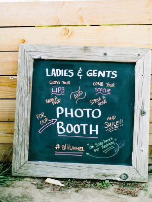 Rustic chalkboard photo booth sign.