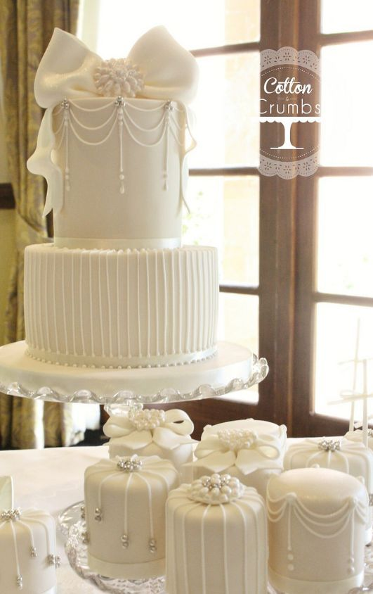 Featured Cake: Cotton & Crumbs; Classic two tier statement bow wedding cake