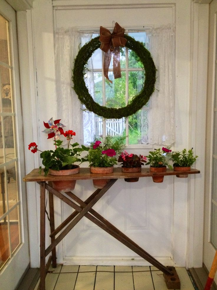 old ironing board planter...