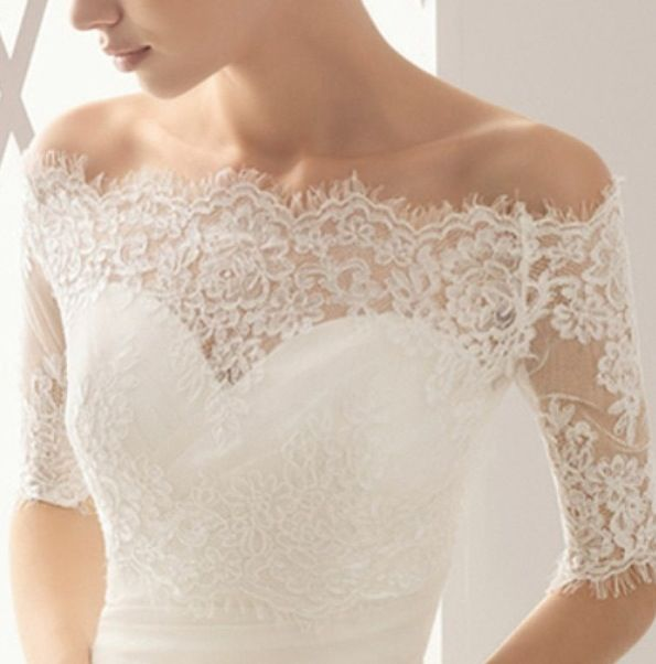 A lace wedding jacket might be a good solution if you fall in love with a dress that you can't wear in the church.