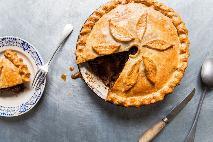 The crust on this beef pie is touched by the lovely earthiness of blue cheese and surrounds rich braised beef.