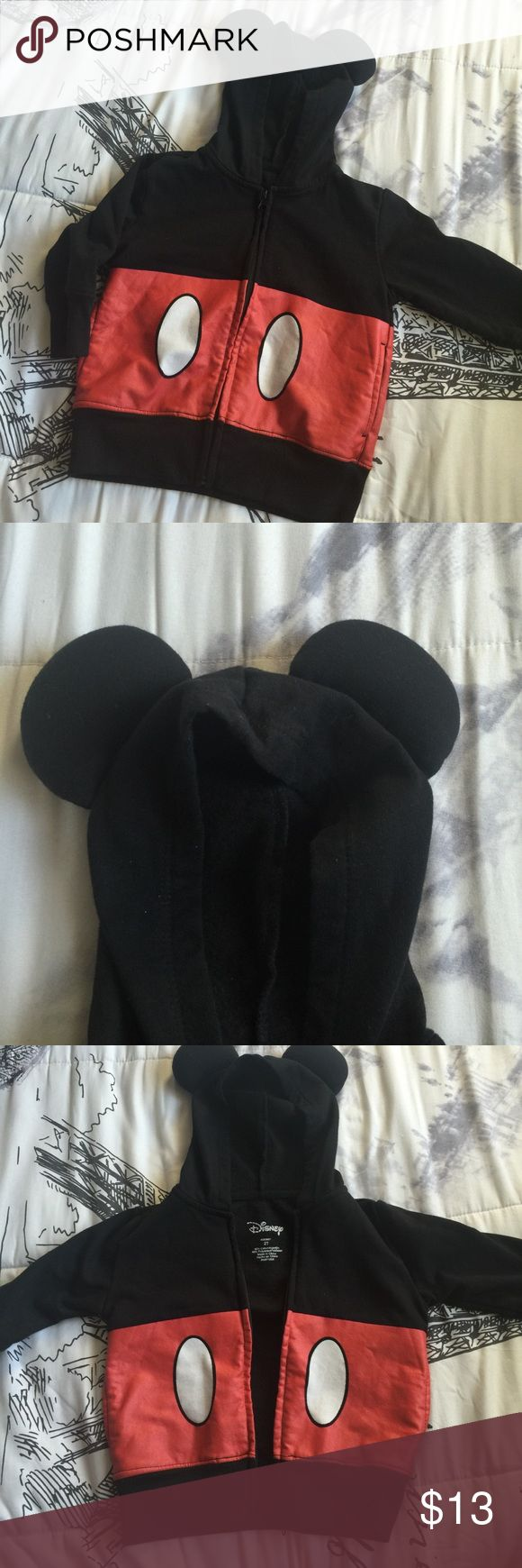 cute disney mickey mouse ears hood jacket 💕 very cute disney mickey mouse jacket! features a zipper and a hood with ears like mickey mouse. perfect for disney lovers! ❤️ fits a 2T. the red part feels like sort of an almost rough leathery material. no trades. tags: disneyland disney disney baby mickey mouse minnie mouse hoodie jacket outerwear black red Disney Jackets & Coats