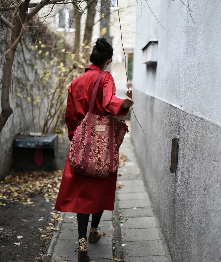 Women in red. Red coat. Red bag. BOHO style.