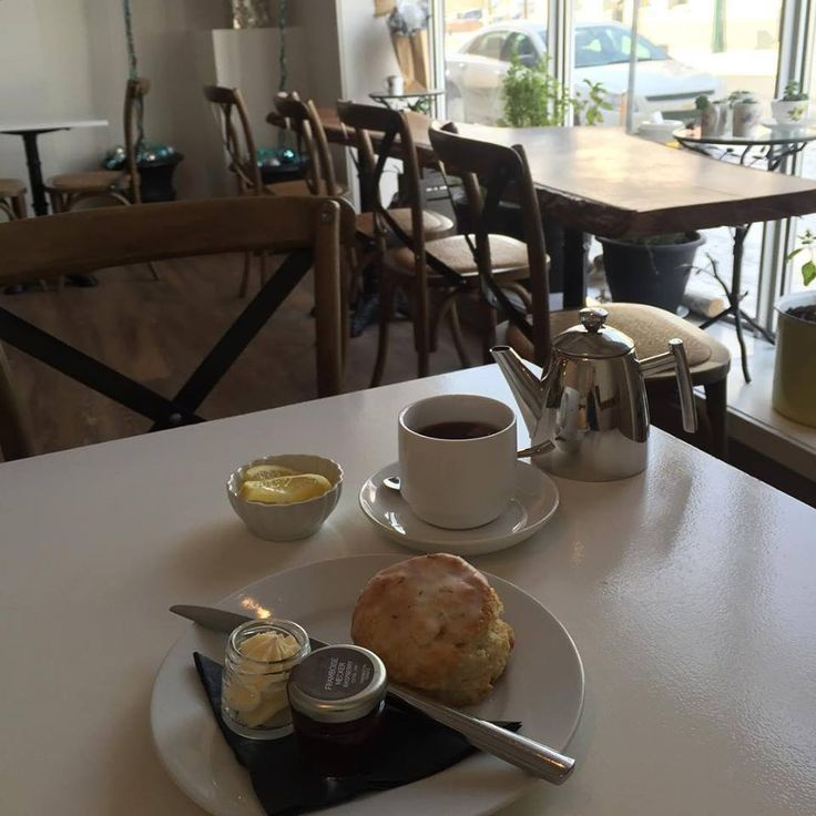 A Lemon Lavender Scone with Whipped Honey Butter, a spot of Assam tea, and some people watching. Lovely!