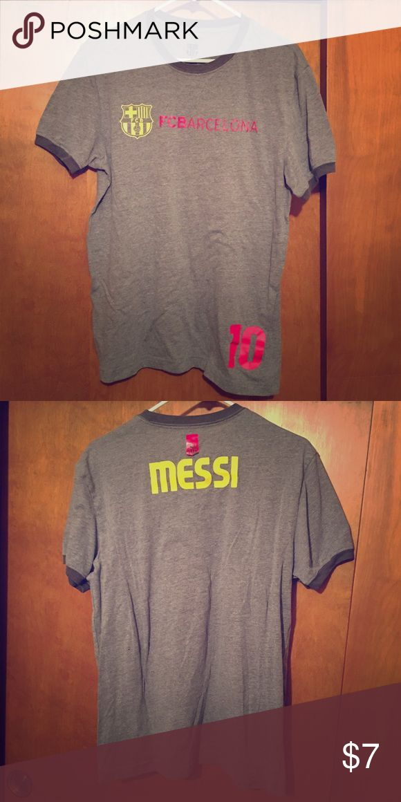 """FC Barcelona """"Messi"""" Hero T-shirt FC Barcelona """"Messi"""" jersey style hero t-shirt featuring name, number, and club banner detail. Men's size M. FC Barcelona Shirts Tees - Short Sleeve"""