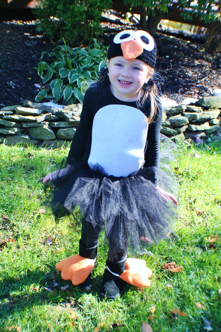 Inspiration for my penguin costume... Hat with penguin face, black tee with white belly, black leggings, black & white tu-tu & orange felt for the feet?