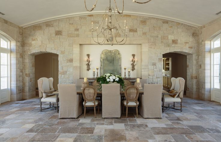 Dining area in French Country Provençal Gustavian Style Home with reclaimed stone and arches.