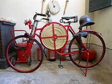 Firefighting Bicycle.  Pretty neat.  Look at the fire hose.  Wow.. seems Unique.