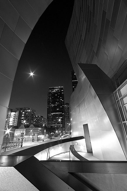 July 2012: 3rd Place - MICHAEL BANDY, 30, DISPATCHER, PICO RIVERA, CA - Late night shooting RAW allows recover of shadows w/o blowing out highlights. Contrast curves & straight lines. Architect, Frank Gehry— Walt Disney Concert Hall inspires. TECH INFO: Nikon D300S w/Sigma 10–20mm f/4–5.6 EX DC lens on Giottos tripod & ballhead; 30 sec at f/18, ISO 200. Exposure & b&w conversion in Adobe Photoshop Lightroom 3; blur, sharpening & noise reduction in Photoshop CS5; contrast in Nik Color Efex…