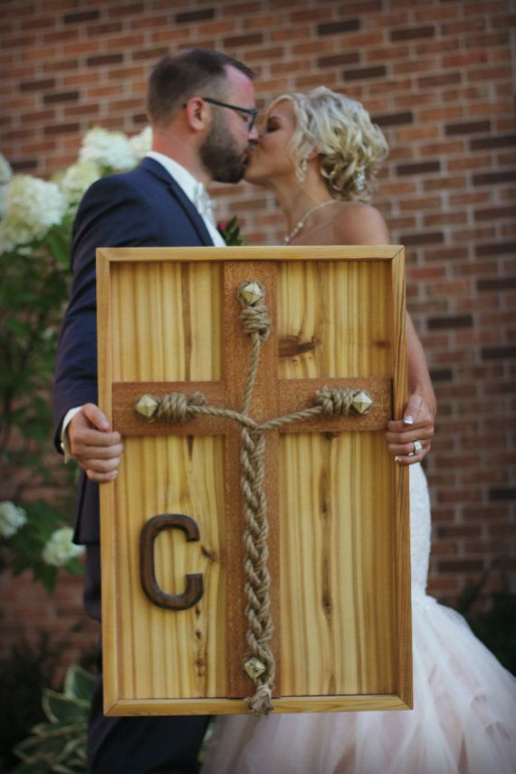 Enough with unity candles and sand in a jar, This is a wedding braid made of hand selected western cedar with a 4 inch wide mahogany cross centered,