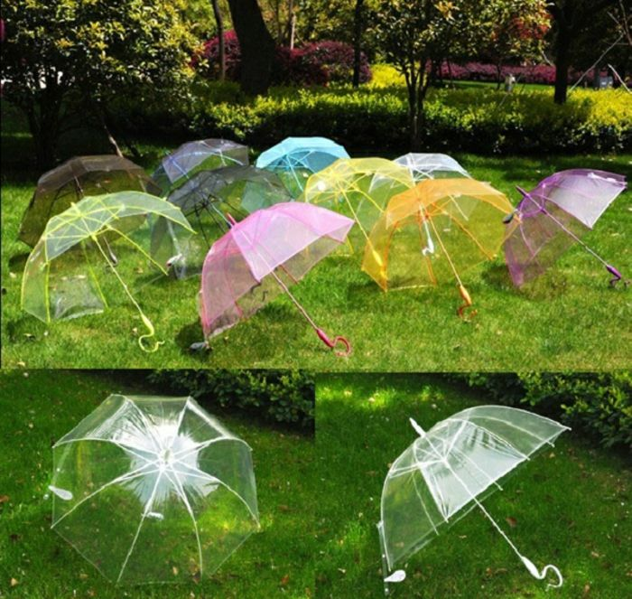durchsichtige regenschirme in bunten farben regenschirm
