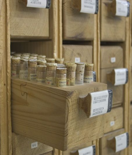 HOW WE STARTED_Pharmacy korres, bottles, glass, wood, brown, white, etiquettes, letters, vintage, old, retro, cupboard, shelve, drawers, herbal remedies, homeopathy, natural engriedients