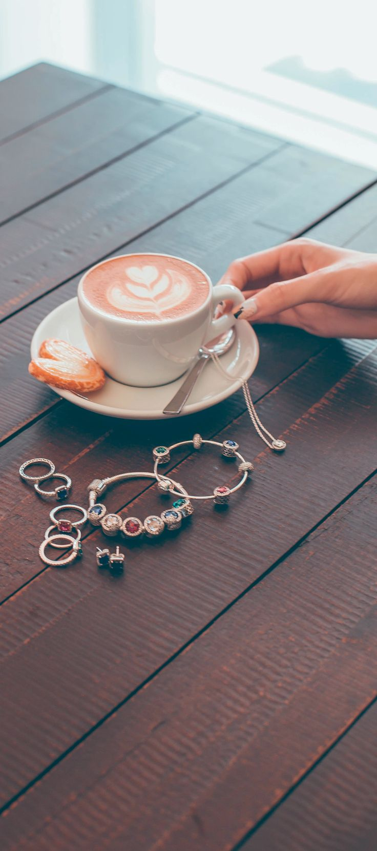 Time for coffee and vivid PANDORA jewellery in sterling silver and multicoloured crystals, perfect for adding some colour to the grey season. Image by Christabel Chua.