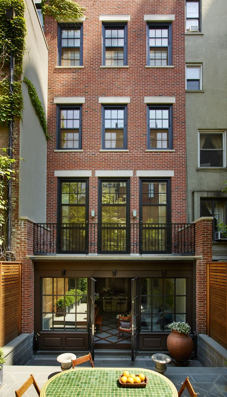 Extended garden level and beautiful floor to ceiling Windows into the deck... Townhouse perfection!  An Elegant New York Townhouse Is Reborn Photos | Architectural Digest