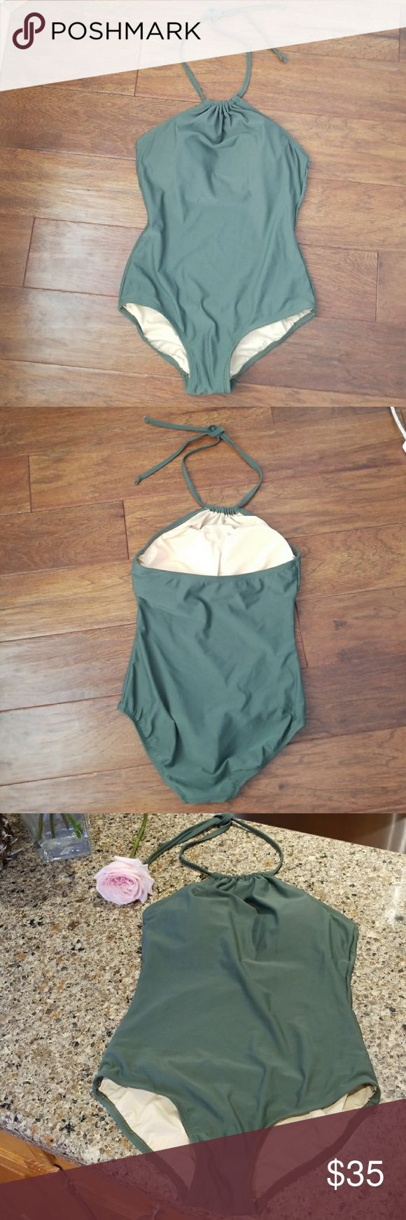 new Swimsuit Worn once for 1 hour by the pool at the hotel, never been in the water other than washed once in a mild soapy water. Padded removable cups, halter top, bottom provides full coverage.  Clean, no odors, like new.  The photos with a model are to show fit only, the only swimsuit for sale is the military green one piece. Sea and Sand Swim One Pieces