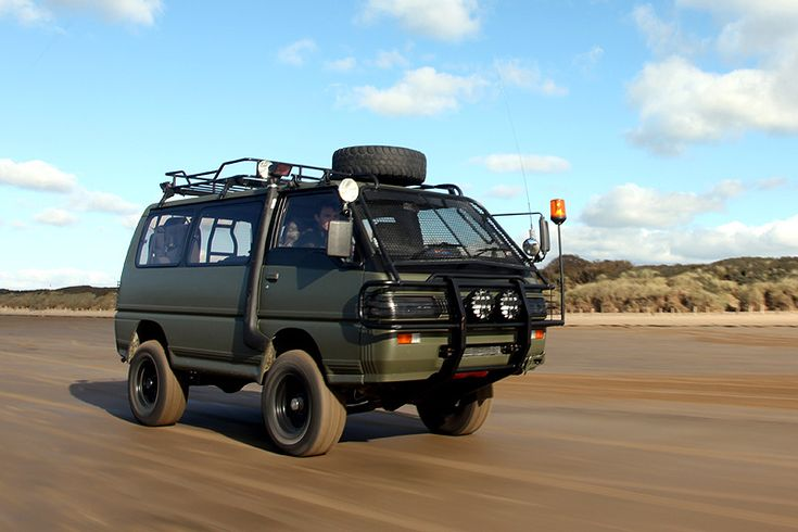 https://flic.kr/p/8PP4KQ | Military Spec Delica | Rolling shot of my Delica at the October 2010 'Beach Party' on Brean Sands near Weston Super Mare. I took this while hanging out of the side of my mates T25 Transporter. My friend Ross was driving the Delica