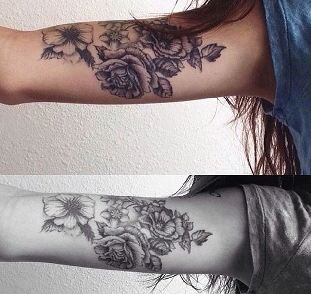 A beautiful rose arm tattoo for women