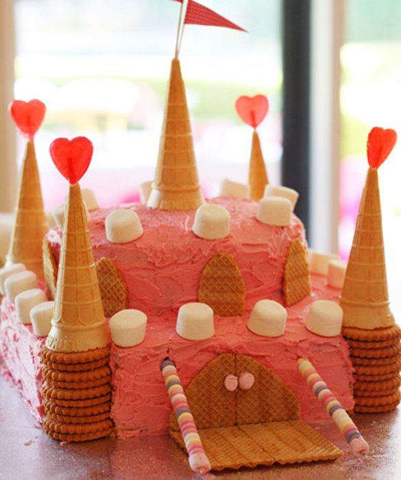 50 Easy and Delicious Kids' Cakes: Castle Cake with pink frosting, fluffy marshmallows, ice cream cones and wafer cookies