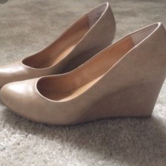 Nine West nude wedges size 10 Awesome nude wedges in a size ten. Worn for about 20 minutes (with stockings) but they're just too big for me (I'm a size 9 so it's not like they run big or anything) willing to negotiate price! I paid 45. Nice low wedge that can be fancy for events (like what I wore it for) or dressed down for every day work. Nine West Shoes Wedges