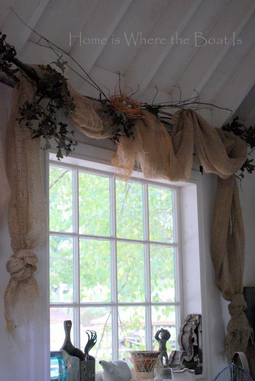 """Landscaping burlap draped over twig curtain rods made an adorable and very inexpensive window treatment. Plus, no sewing!"""
