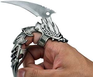 """Upgrade your dinky, weak human fingers with the mighty dragon claw ring to experience the power of having a 2"""" stainless steel blade affixed to your fingers..."""