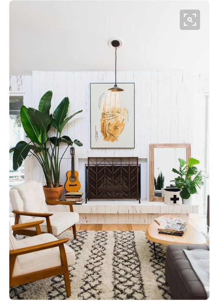 Plants, white wood wall, and palette.