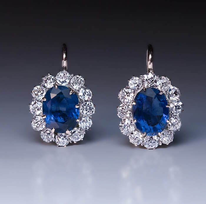 made between 1908 and 1917 in Warsaw, Poland (part of the Russian Empire at that time) Each 14K gold earring is centered with an oval blue sapphire encircl