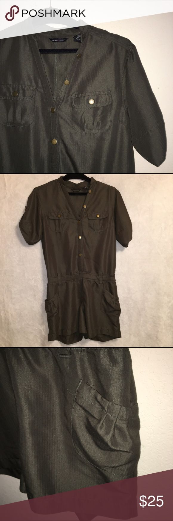 New York &a Company Olive Green army Romper Love, Love ❤️ Love this classic army green short sleeve romper. Button up top with pocket . Gently used, No Pilling, No stain, No smoking Home.  68% Rayon/32% Polyester New York & Company Pants Jumpsuits & Rompers