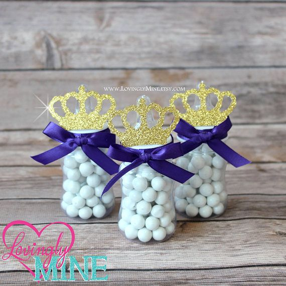 This listing is for 12 favor bottles as pictured. Each is a clear plastic bottle decorated with satin ribbon, satin bow and matching crown made of glitter cardstock. BOTTLES COME EMPTY. CANDY IS NOT INCLUDED. Perfect for many types of candy. Sample is pictured with Sixlets candy. Each