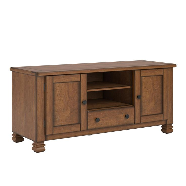 Get ready to host your next movie night with the Altra Summit Mountain Wood Veneer 55 inch TV Stand. This TV Stand accommodates up to a 55 inches flat panel TV. This beautiful TV Stand features real wood veneer construction and solid wood legs.
