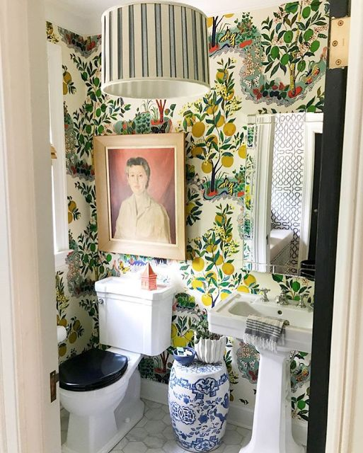 Pencil and Paper Co. A lot of design in this little bathroom featuring Schumacher's Citrus Garden wallpaper. The blue and white Chinese garden stool is a perfect touch.