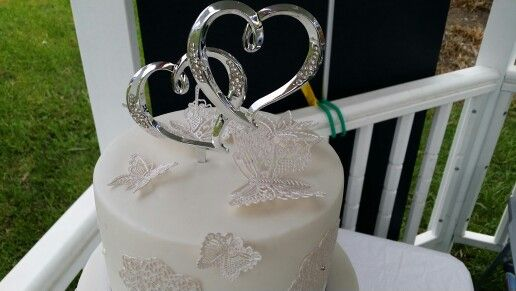 Wedding cake topper with edible lace butterflies