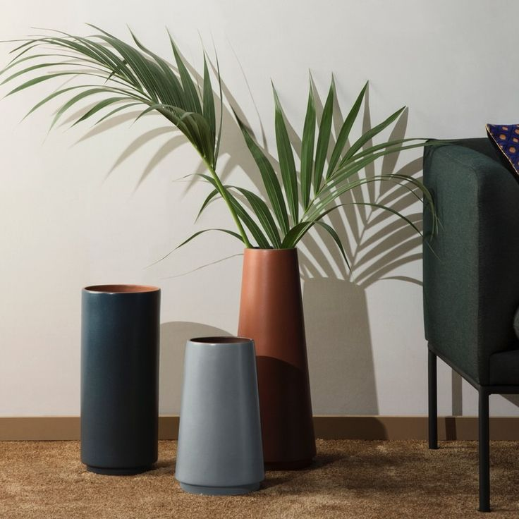 Ferm LIVING Dual Floor Vase Medium in Blue. A minimal design floor vase in dark blue with a terraccota coloured interior and a cylindrical shape. Sleek and understated crafted in stoneware dual floor vase will look stunning standing alone or with the other dual vases, holding any blooms or branches  as well as on its own as a beautiful object.  A new height floor vase offering dimension and layering for your home interiors.