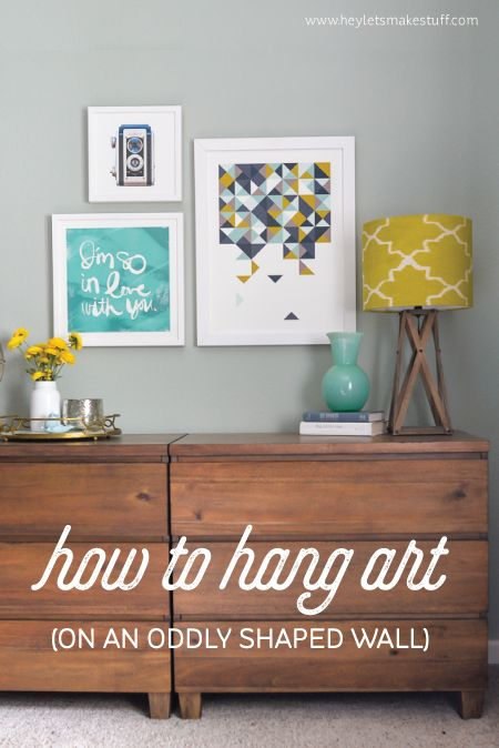 Learn How To Hang Artwork To Disguise An Oddly Shaped Wall.