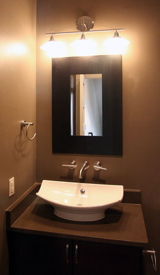 Make Photo Gallery Warm Minimalist Powder Room Design Ideas with Awesome White Sink on the Brown Wooden Sink Cabinets and have a Simple Mirror that have a Beautiful Wall