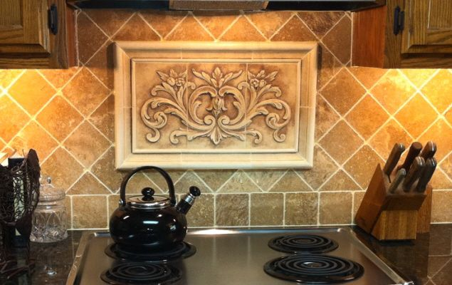 Kitchen backsplash insert using our hand pressed Floral tile, surrounded by Plain Frame liners all in a Warm Cobblestone glaze. Complete tile set is 14 x 22 inches.