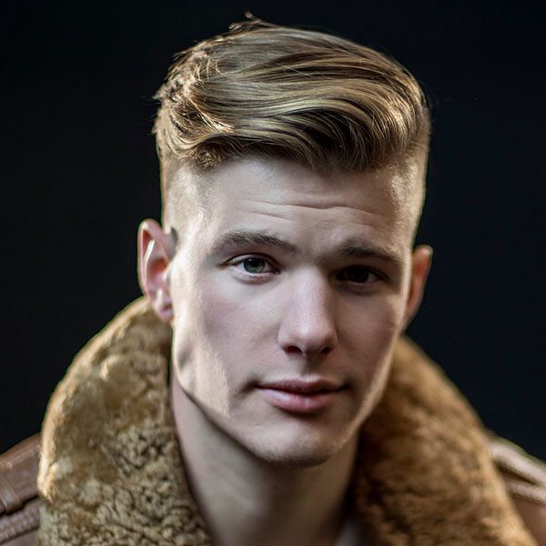 The medium length hair on top is called a disconnection because of the lack of transition between longer hair and shaved sides. It makes for a bold look that stands out from the crowd and is easy to style.
