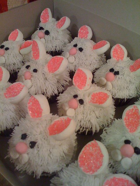 Bunny Cupcakes - cut large marshmallow in sections for the ears, sprinkle sticky part with colored sugar.  I would suggest stopping there!  Just use smooth icing on top.  Simplicity.  Who really wants to think about biting into an actual rabbit?